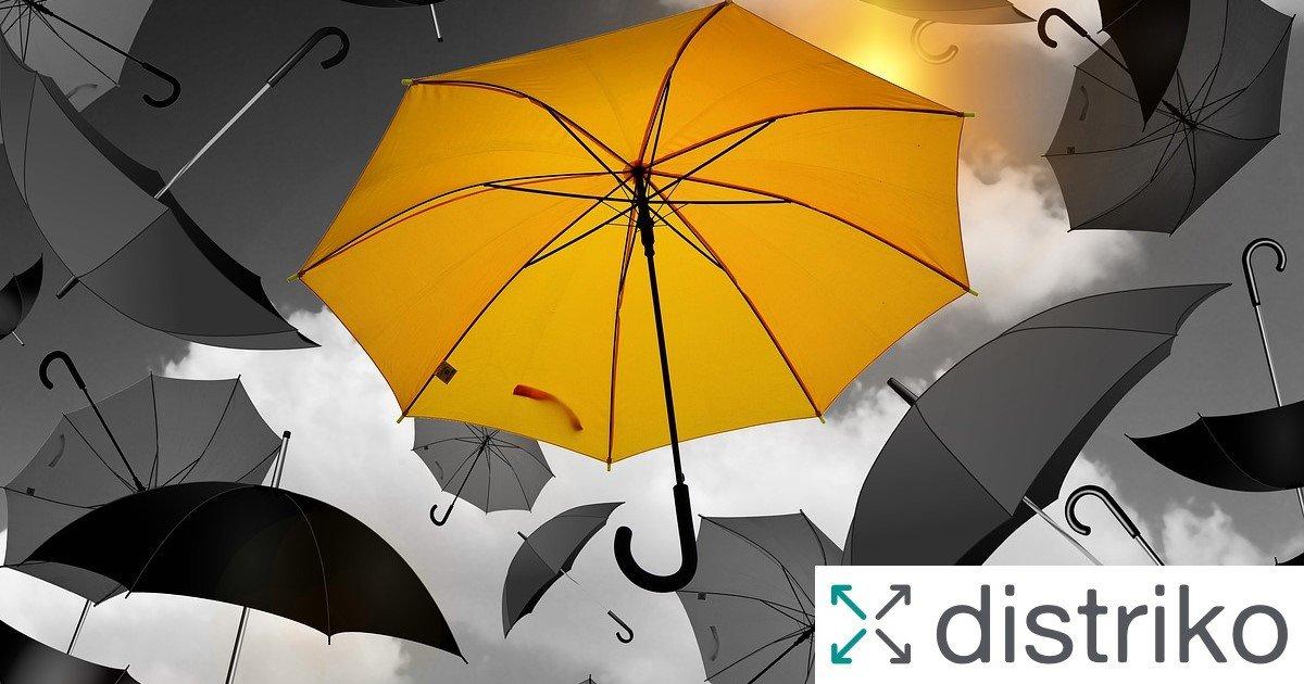 Ein gelber zwischen vielen grauen Regenschirmen mit Text USP und distriko Logo