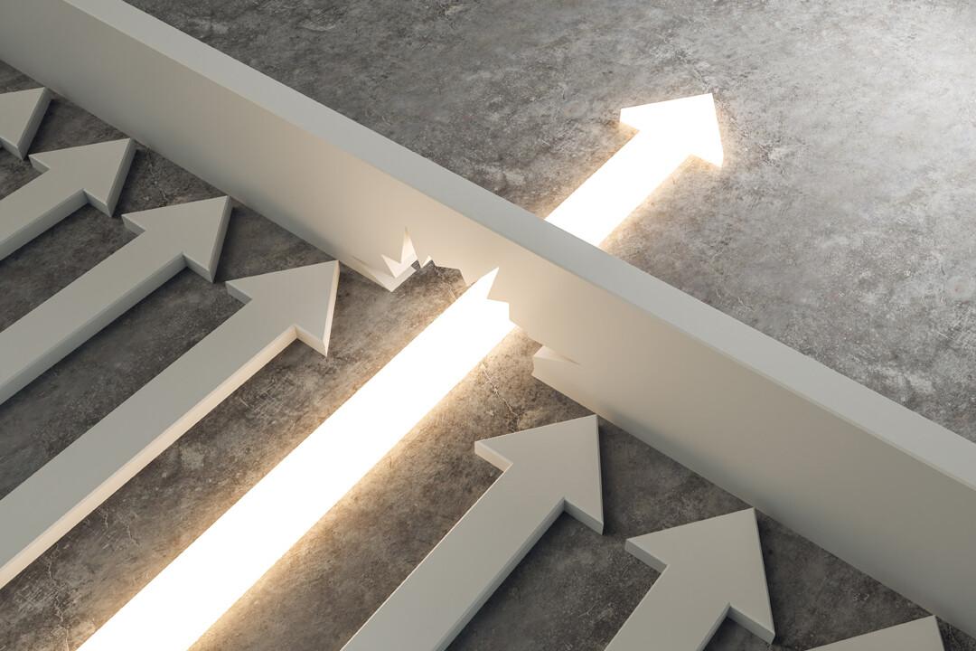 Ein Pfeil durchbricht eine Barriere - Unsere Leistungen bringen sie weiter